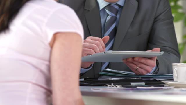 HD: Financial Advisor Using Tablet Computer