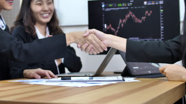 Financial Business sign contract Agreement and Handshake