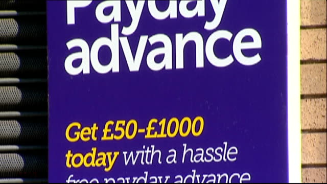 Financial Conduct Authority announce new rules for payday loan companies 172013 / R01071304 Vairuos shots of signs in windows of payday loan...