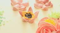 Finishing petal decoration on cake