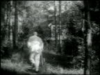 Finnish composer Jean Sibelius walking toward house Anio Jean Sibelius w/ two unidentified guests in home Jean Sibelius sitting at piano MS Jean SOT...