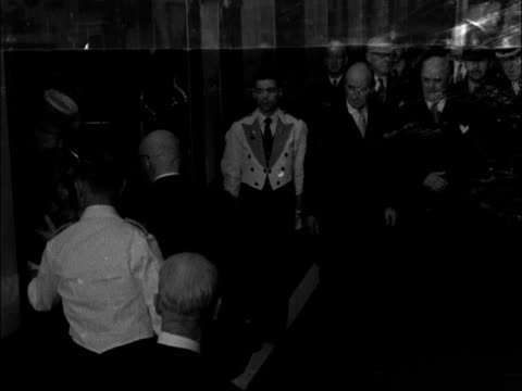 Finnish President Urho Kekkonen visits UK ENGLAND London Victoria Station EXT Various of Finnish flag flying from building / Harold Macmillan MP...