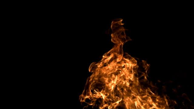 SLO MO, fire burning against black background