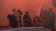 A fire destroyed 3 Wrigleyville businesses The Samah Hookah Lounge The Roadhouse 66 and Thai Classic There were no injuries Firemen Using Fire Hose...