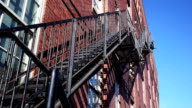 Fire escape on red brick building facade