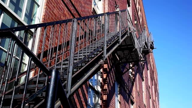 Fire escape on red brick building facade