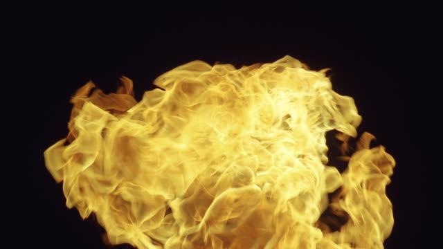 CU Fire explosion against dark background