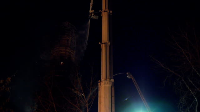Fire extinguishment on a belfry at night