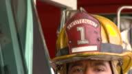 CU TD PORTRAIT Fire fighter in uniform in fire station/ Richmond, Virginia
