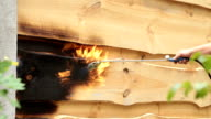 Fire flame burns a wooden surface.