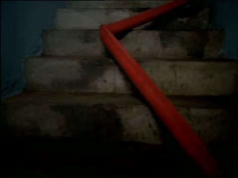 Fire hose straightens as it fills with water in stairwell
