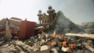A fire in the debris of the building caused by the Haiti earthquake of January 2010