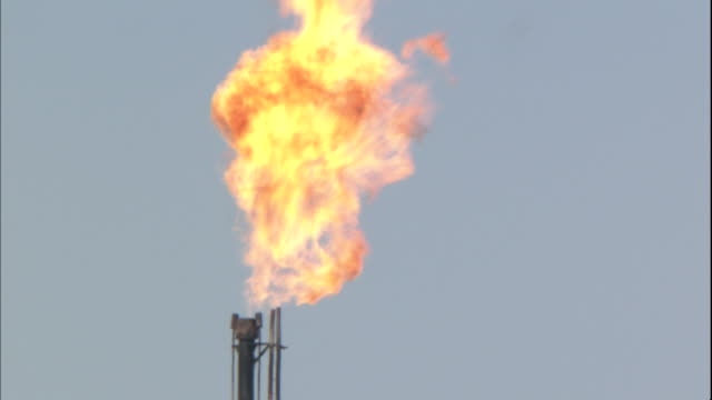 Fire spurts from an oil field chimney in Turpan Silk Road China