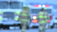 Fire Trucks & Firemen Defocused