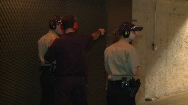 Firearms Instructor Helping Police Recruits on September 07 2013 in Chicago Illinois