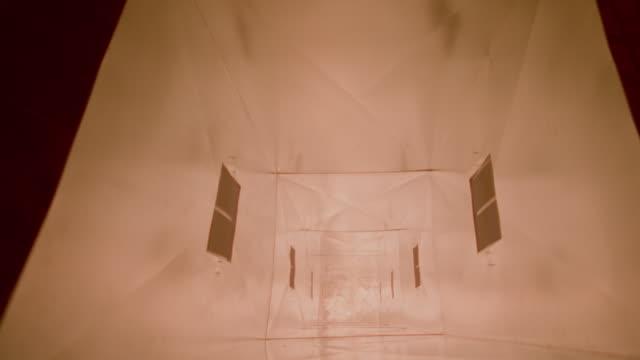 Fireball + flames rushing through ventilation shaft toward camera