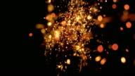 SLO MO Firecracker sparkles on black background
