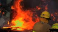 CU SLO MO Firefighter watches falling burning debris / Ellensburg, Washington, United States