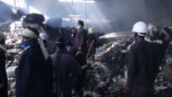 Firefighters extinguish a fire broke out at a cotton factory in the Jacros industrial zone north of Addis Ababa Ethiopia on March 28 2017