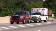 Firefighters, fire trucks on emergency site. Rescue mission, highway accident.
