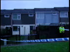 Firefighters stirke Events ITN WALES Newtown GV Cordoned house where Violet Davies died in fire MS Window of house Flowers laid on pavement