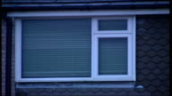 Firefighters stirke Events WALES Newtown Police tape TILT UP police officer standing guard in street where pensioner died in house fire Window of...