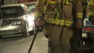 Fireman Walking From Firetruck