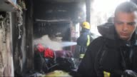 Firemen extinguish fire at a house belongs to a Palestinian family in Betlehem West Bbank on November 04 2015 Israeli army forces Tuesday fired tear...