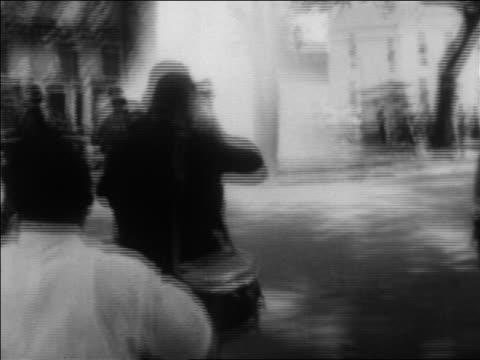 PAN firemen hosing demonstrators on street in civil rights protest / Alabama / newsreel