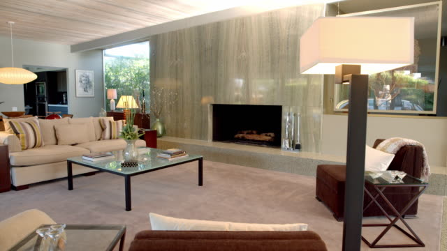 TS fireplace with green granite surrounds in mid-century modern living room from 1955