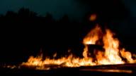 Fires burn near liquid propane tanks.
