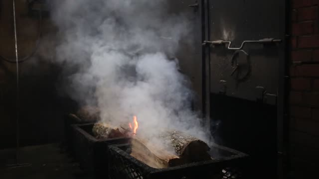 Firewood is burned creating smoke for smoking turkeys at Greenberg Smoked Turkeys in Tyler TX on November 7 2017 Photographer Luke Sharrett Shots CU...