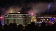HA WS PAN Fireworks exploding in sky above casinos and cityscape / Las Vegas, Nevada, USA