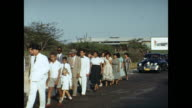 1954 HOME MOVIE First Communion procession walking along road / Aruba, Lesser Antilles