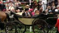 First day of Royal Ascot Queen arrives Spectators in stands and Royal Carriage along carrying Queen Prince Charles and Camilla / Princesses Beatrice...