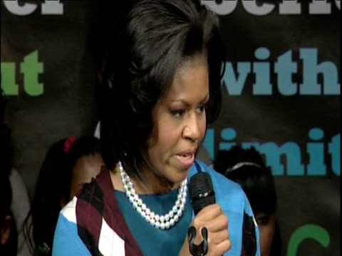First Lady Michelle Obama delivers inspirational speech to female pupils during surprise visit to Elizabeth Garrett Anderson Language School whilst...