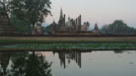 First Light of Day coming to Wat Mahathat at the Historical Park Time Lapse, SUKHOTHAI, Thailand