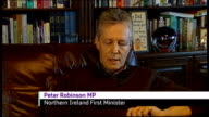 First Minister of Northern Ireland speaks about wife's affair FILE Peter Robinson waving from stage with his wife Iris Robinson FILE pix end Peter...