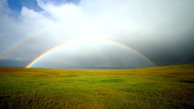 First person perspective moving towards a double rainbow