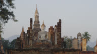 First Rays of Sun shining on Wat Mahathat at the Historical Park, SUKHOTHAI, Thailand