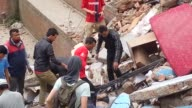 First rescue operations take place after a 79 magnitude earthquake struck Kathmandu The military local people and tourists can all be seen helping...