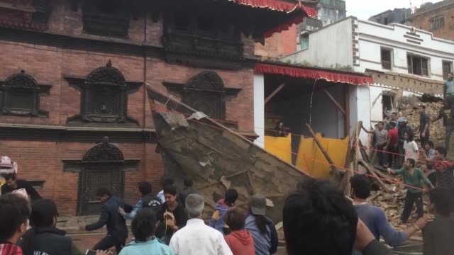 First search and rescue operations take place in Kathmandu just minutes after the 75 magnitude earthquake hit the Nepalese capital Local residents...