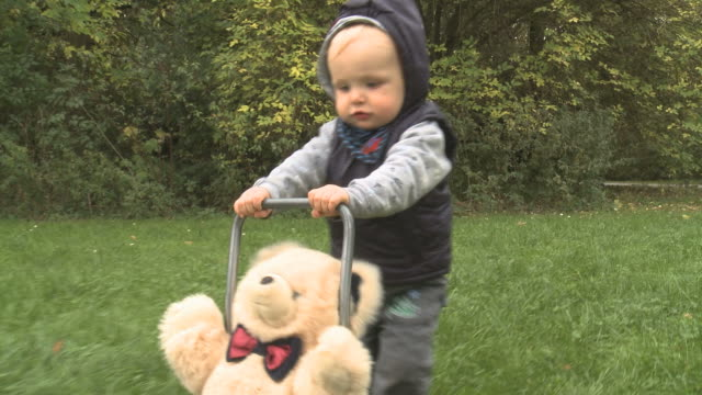 First steps of a one year old boy