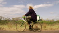 MS TS POV Fisher riding a bicycle and going to selling her baits / Mato Grosso do Sul, Brazil