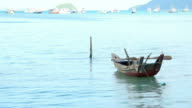 Fisherman boat  floating in Chalong Bay Beach Phuket Thailand
