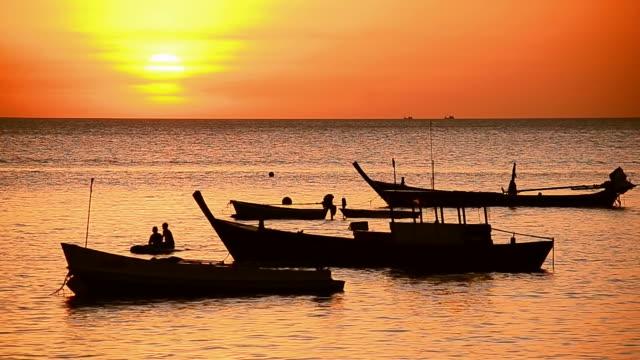 Fisherman boats on sunset beach
