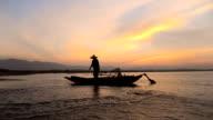 Fisherman fishing at lake in Morning, Thailand.