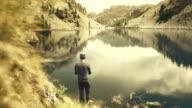 Fisherman fly fishing at lake