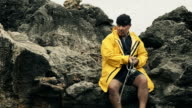 Fisherman on a rocky coast