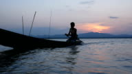 Fisherman on longtail boat
